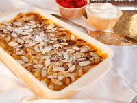 Bread Pudding topped with slivered almonds.