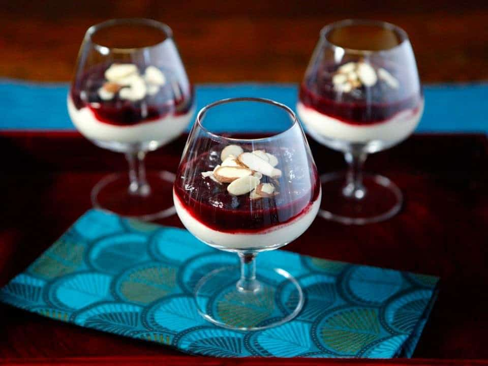 3 cheesecake parfaits in miniature wine glasses.