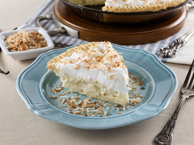 Coconut Cream Pie – Flaky All-Butter Crust Filled with Coconut Cream and Topped with Lightly Sweetened Whipped Cream and Toasted Coconut. Nostalgic, Family-Inspired Recipe from Kelly Jaggers.