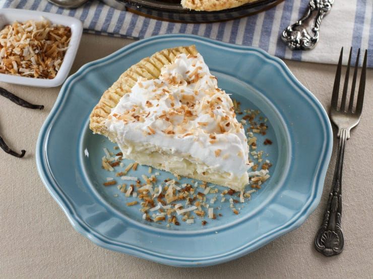 Coconut Cream Pie– Flaky All-Butter Crust Filled with Coconut Cream and Topped with Lightly Sweetened Whipped Cream and ToastedCoconut.Nostalgic, Family-Inspired Recipe from Kelly Jaggers.