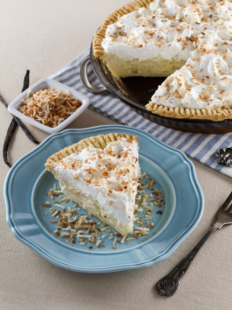 Coconut Cream Pie– Flaky All-Butter Crust Filled with Coconut Cream and Topped with Lightly Sweetened Whipped Cream and ToastedCoconut.Nostalgic, Family-Inspired Recipe from Kelly Jaggers