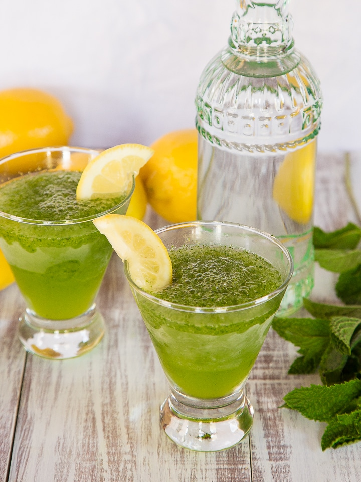 Spiked Limonana - Ice-blended lemonade with fresh mint and a splash of vodka. Frosty summer cocktail.