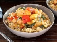 Curried Vegetable Stew - A healthy and delicious vegan, gluten free entree with cauliflower, chickpeas and greens in a creamy curry-flavored coconut sauce.