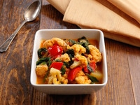 Curried Vegetable Stew - Healthy and delicious vegan, gluten free entree with cauliflower, chickpeas and greens in a creamy curry-flavored coconut sauce.