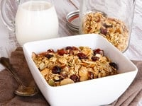 Maple Toasted Muesli - Rolled Oats and Flavorful Nuts Toasted with a Touch of Maple Syrup, Tossed with Dried Fruit. Healthy Breakfast or Snack. I became hooked on muesli several years ago, when my husband and I spent a few months in England working on a project he was involved with. We rented an apartment in the West End, and just down the street there was a little mini-market with gourmet items - large wheels of cheese, charcuterie, jams and honey. There was a small section for pantry goods, where they stocked a couple of varieties of muesli. It became my favorite breakfast-- a bowl of oats, nuts and fruit with a splash of cold milk. So satisfying and healthy! Here in the States a few varieties of muesli are available in health food stores, but none are organic and only one is certified gluten free (but it contains soy, which I try to avoid). Knowing the basic ingredients, I wanted to create my own variety of muesli from scratch that includes all of my favorite healthy ingredients... organic rolled oats, pumpkin seeds, dates, etc. Raw muesli is lovely, but I thought it might be nice to toast the oats and nuts with a touch of maple syrup. The result is a lightly sweetened, crunchy muesli, a perfect autumn breakfast or snack. Try it with cold milk, or heat it up together with milk to create a hot oat cereal. Add a handful to yogurt, or simply carry it as a granola-like snack. Each time I make it, my family snacks on it constantly... it's addictive!
