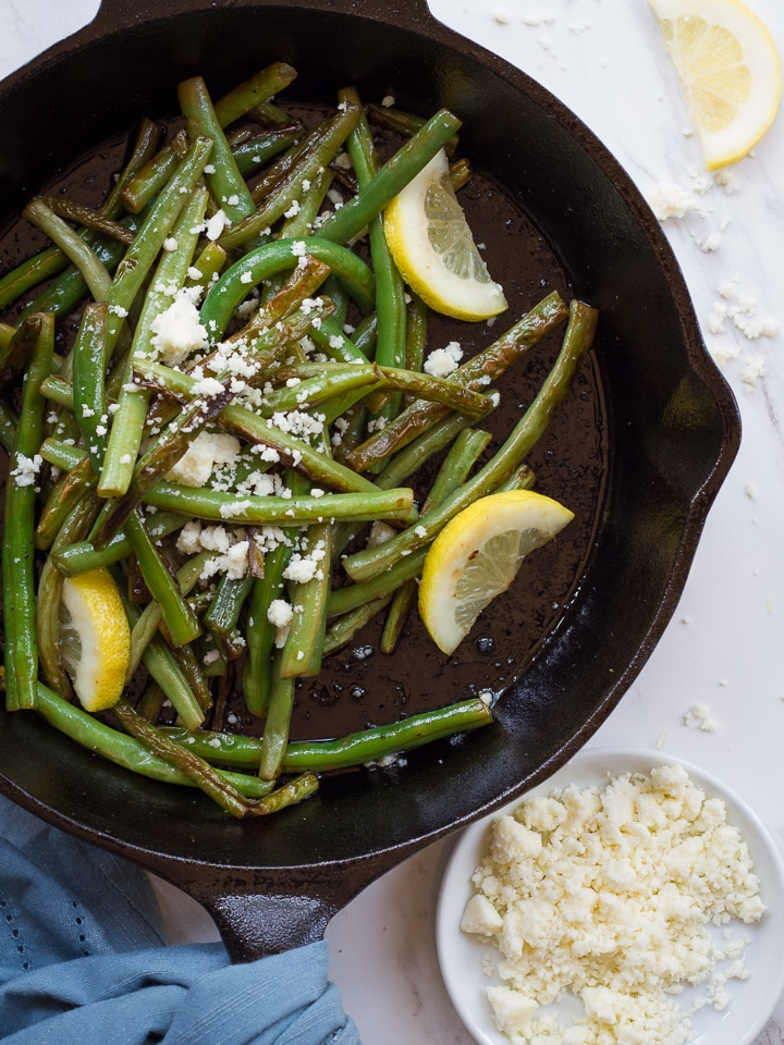 Skillet Seared Lemon Green Beans with Cotija Cheese - Easy flavorful vegetable side dish recipe. A quick hot sear adds major depth of flavor to green beans. Simple and addicting!