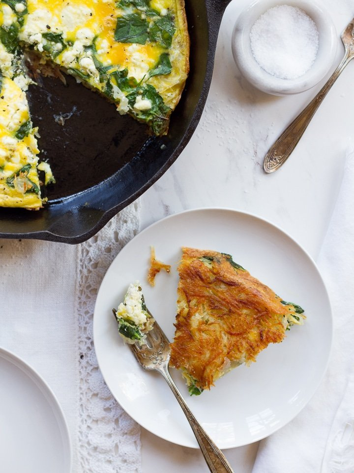 Potato Crusted Spinach Frittata - Gluten free vegetarian frittata with spinach, crumbled goat cheese and a crispy potato crust – perfect for using up leftover hasbrowns! | ToriAvey.com #frittata #glutenfree #vegetarian #potatocrust #potato #hashbrown #spinach #goatcheese #breakfast #brunch #brinner #passover #passoverrecipe #kosher #simplerecipe #easyrecipe