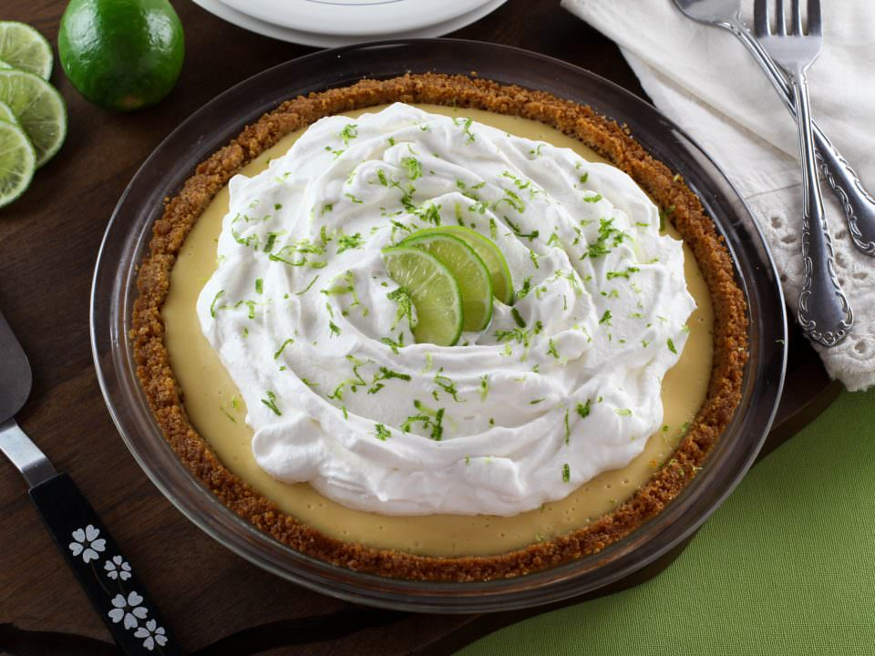 Key Lime Pie - Crisp graham cracker crust with a sweet, tart key lime filling and whipped cream topping. Time-Tested Family Recipe.