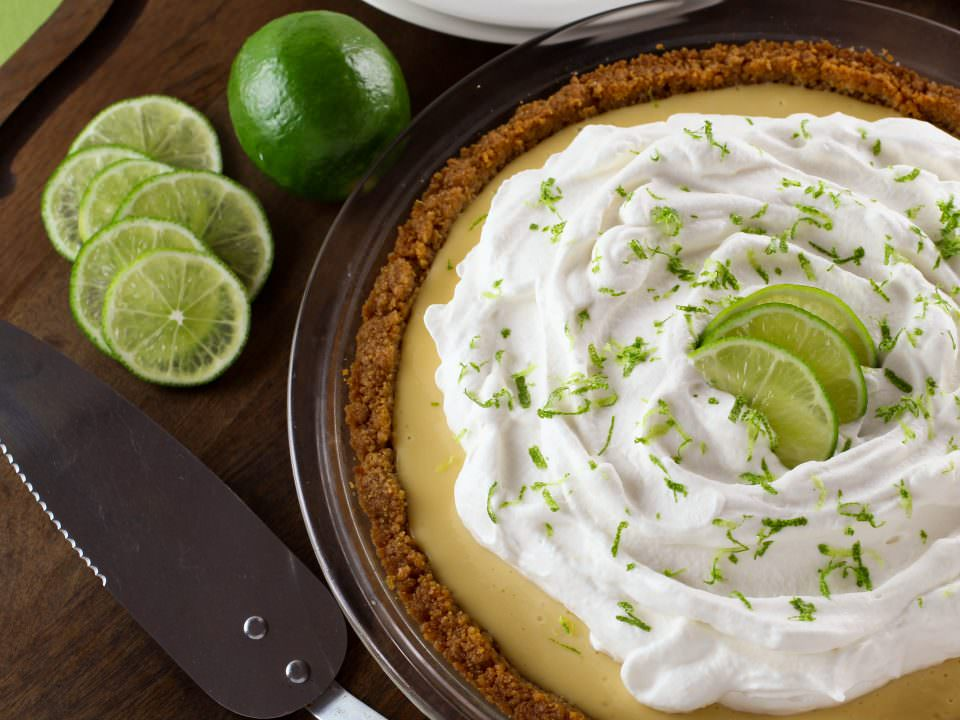 Key Lime Pie - Crisp graham cracker crust with a sweet, tart key lime filling and whipped cream topping. Time-Tested Family Recipe from Kelly Jaggers.