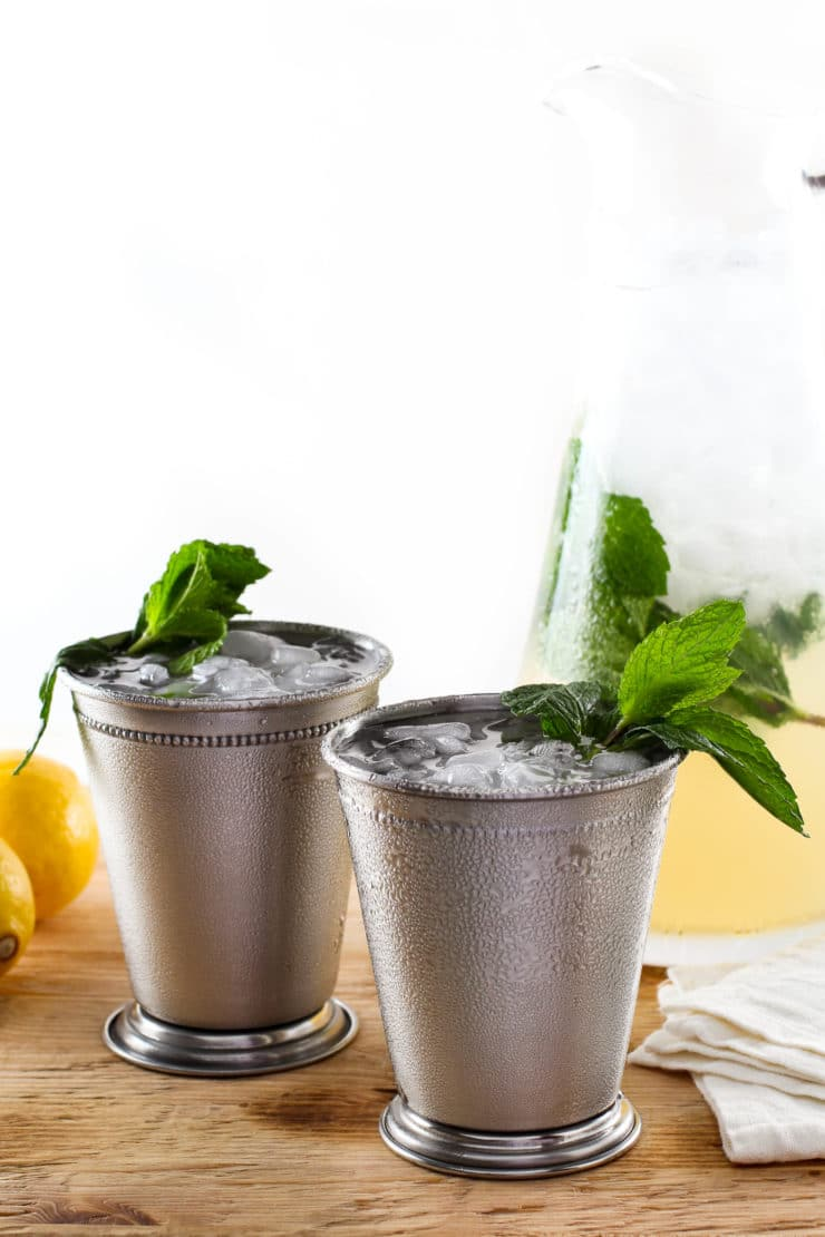 Sparkling Mint Juleps - Sweet, aromatic and refreshing summer cocktail. Bourbon, fresh mint syrup and fresh lemon juice and club soda.