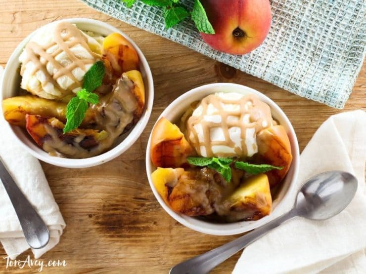Grilled Peach Sundae with Brandy Butterscotch Sauce - Recipe for grilled ripe peaches and creamy caramelized sauce over vanilla frozen yogurt.