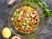 Israeli Salad with Avocado and Mint - Crunchy fresh and healthy salad with cucumber, tomatoes, bell peppers, lemon and mint.