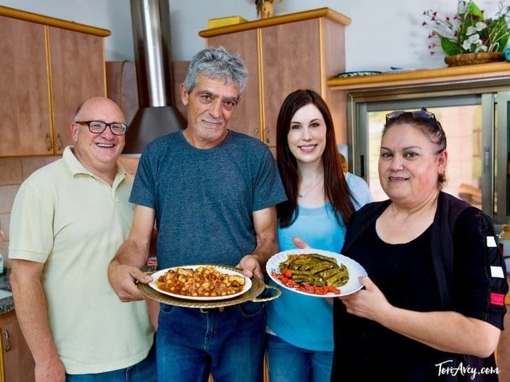 Paul Nirens, Basis family, and Tori Avey present traditional Druze dishes in kitchen - Daliat Carmel, Israel.