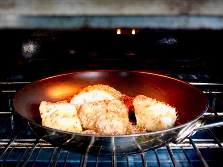 4 Teriyaki Black Cod fillers in skillet under hot broiler in oven.