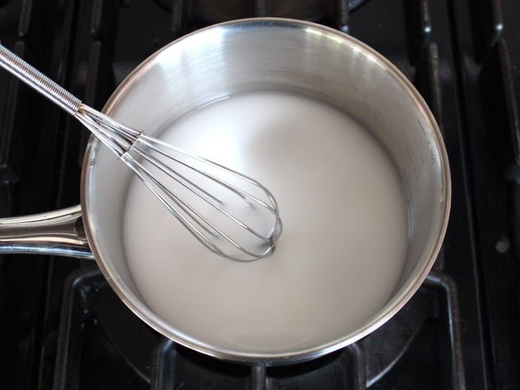 Potato starch and water in small stainless steel saucepan on stovetop.