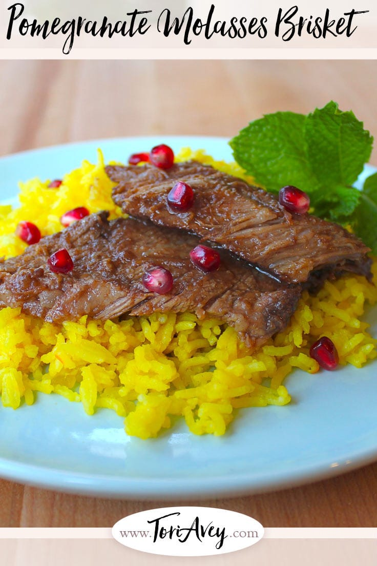 Pomegranate Molasses Brisket - Slow roasted brisket infused with pomegranate molasses, garlic, and spice. | ToriAvey.com #Kosher #brisket #slowroasted #pomegranate #pomegranatemolasses #garlic #holiday #meats #easyrecipe #infused