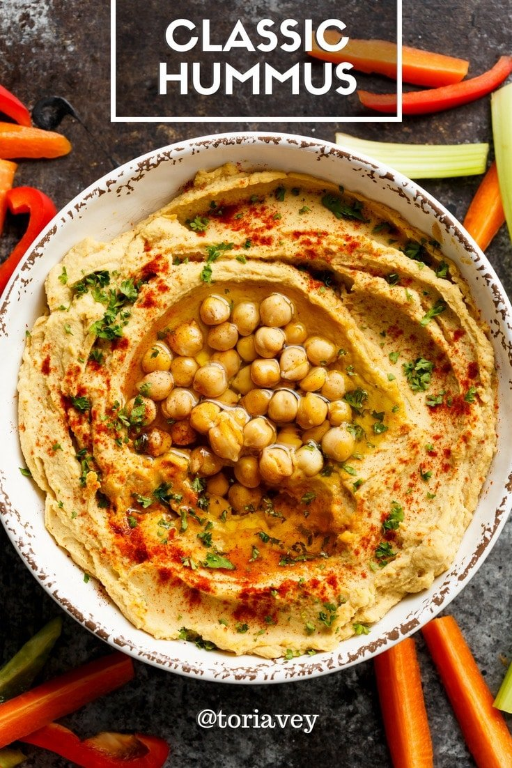 Classic Hummus - make smooth, creamy, authentic Middle Eastern hummus. Includes easy chickpea peeling technique. | ToriAvey.com #hummus #dip #tahini #garlic #lemon #oliveoil #evoo #easyrecipe #vegetarian #vegan #cleaneating #kosher #veganprotein #chickpeas #garbanzobeans #appetizer #snack #healthy #lightenup #glutenfree