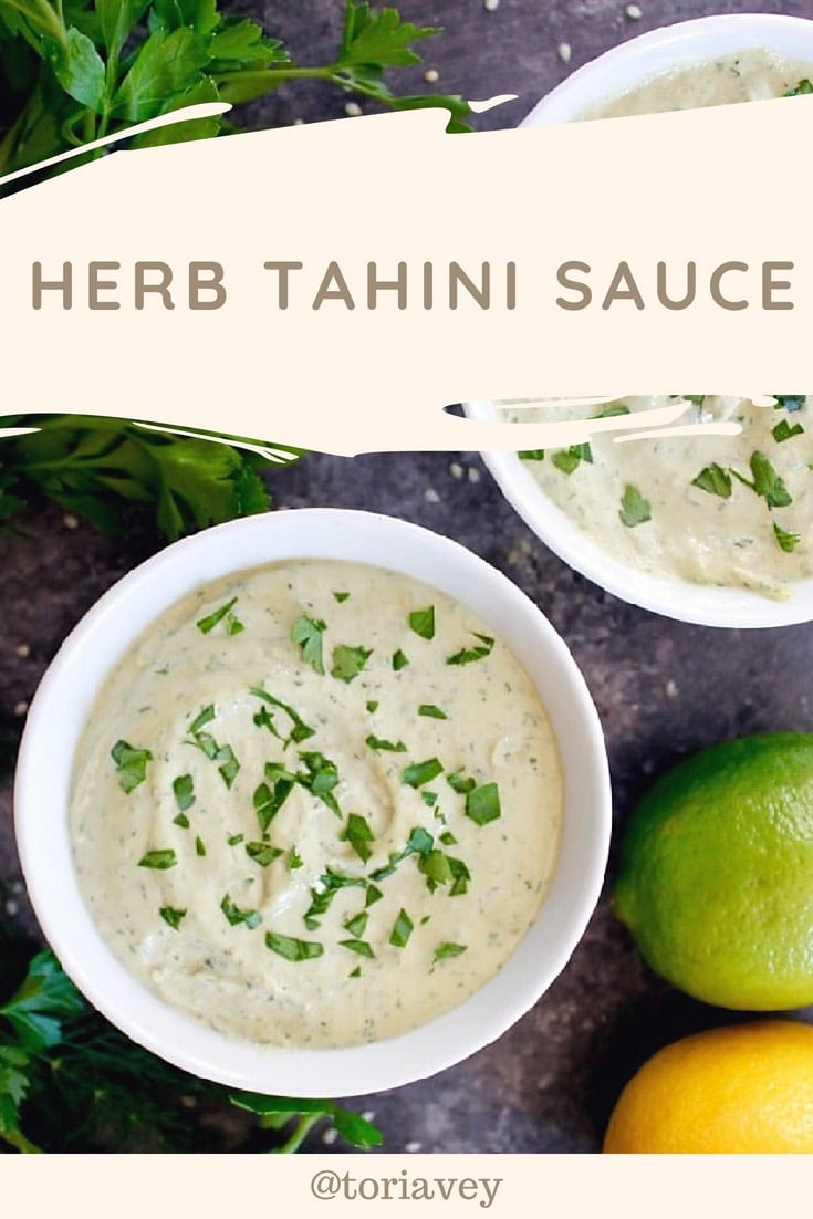 Herb Tahini Sauce - a classic creamy tahini paired with fresh parsley and dill, roasted garlic, lemon and lime juice for a unique and healthy vegan condiment. This saucecan be added to fish, grilled or roasted vegetables, meat dishes and more.| ToriAvey.com #vegan #tahini #herbs #healthy #mediterranean #lemon #lime #TorisKitchen