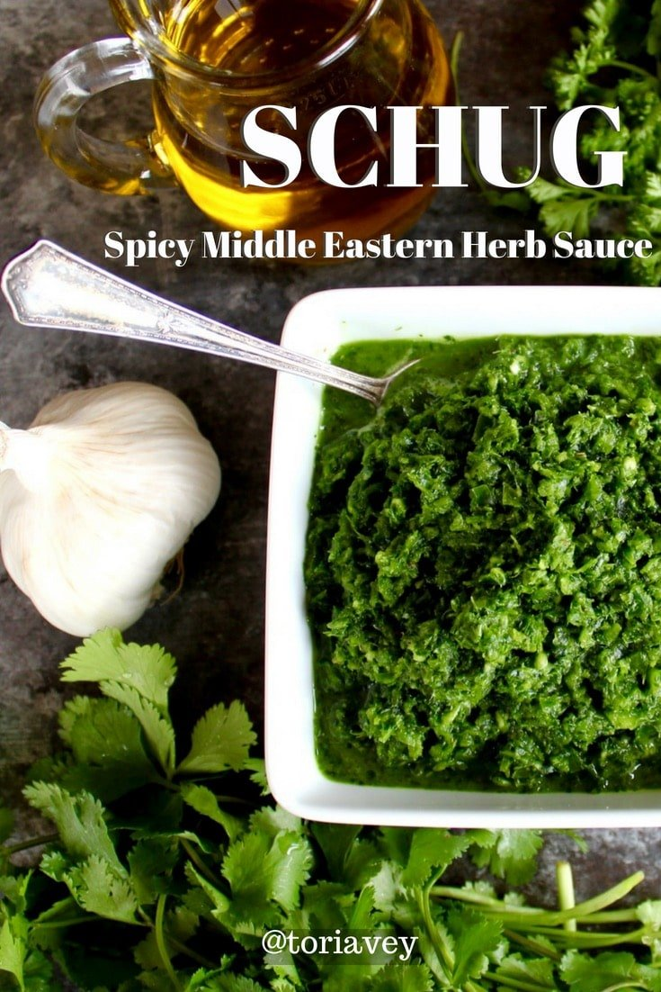 Yemenite Schug - Easy recipe for fiery, herby green Yemenite sauce with cilantro, parsley, jalapeños, garlic, spices and salt. Adds a spicy kick to all kinds of foods. #schug #yemenite #global #cilantro #parsley #jalapenos #capsacin #fiery #spicy #garlic #oliveoil #cardamom #spices #marinade #sauce #relish #kosher #parve #vegan