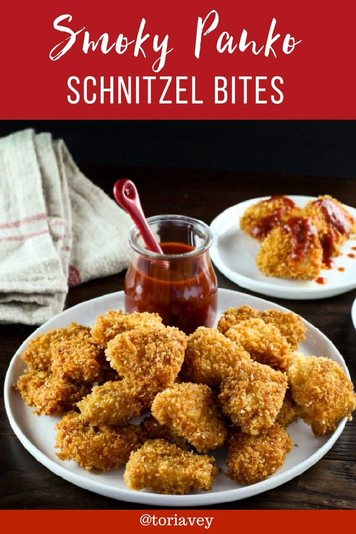 Bite-sized chicken schnitzel pieces coated in smoky, crispy panko and served with spicy-sweet honey sriracha sauce. | ToriAvey.com #schnitzel #chicken #fingerfood #TorisKitchen