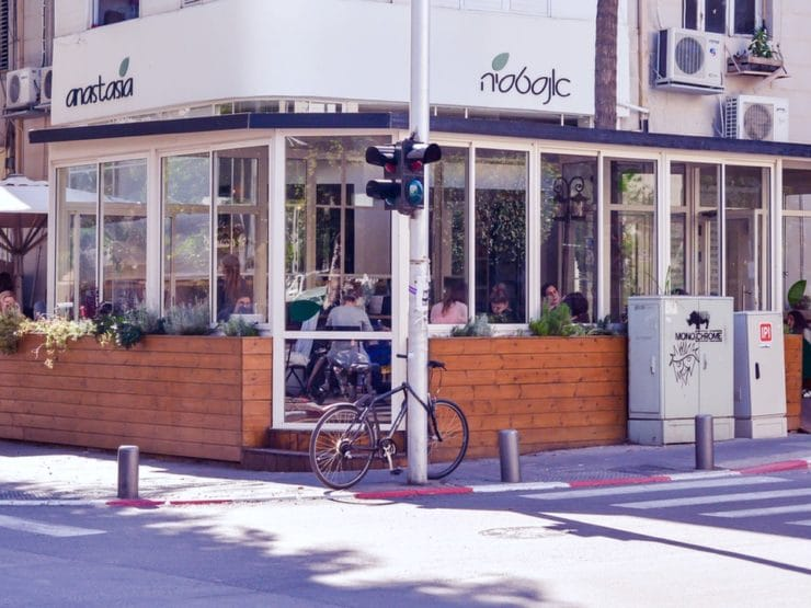 Corner restaurant - Anastasia Restaurant Tel Aviv - at a street intersection with stoplight.
