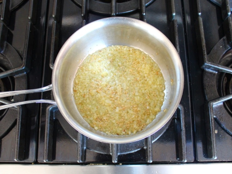 Minced onion in saucepan with garlic, cooked to translucent and starting to turn golden.