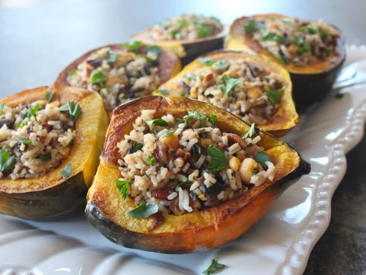 Close up - horizontal shot - tray of Vegan Stuffed Acorn Squash with fresh parsley garnish