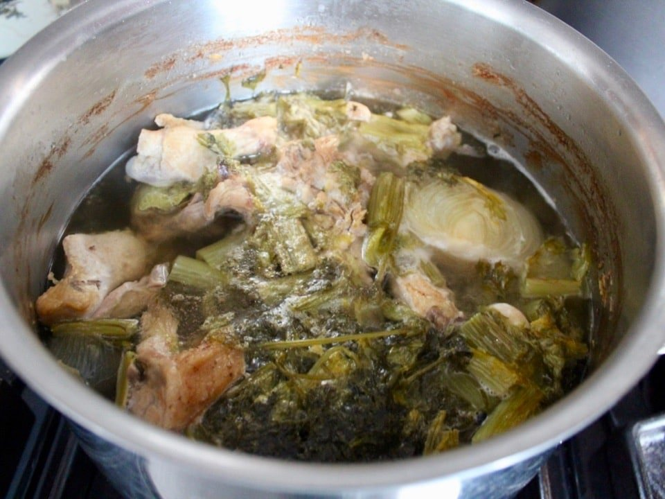 Fully cooked ingredients in chicken stock pot after long simmer.