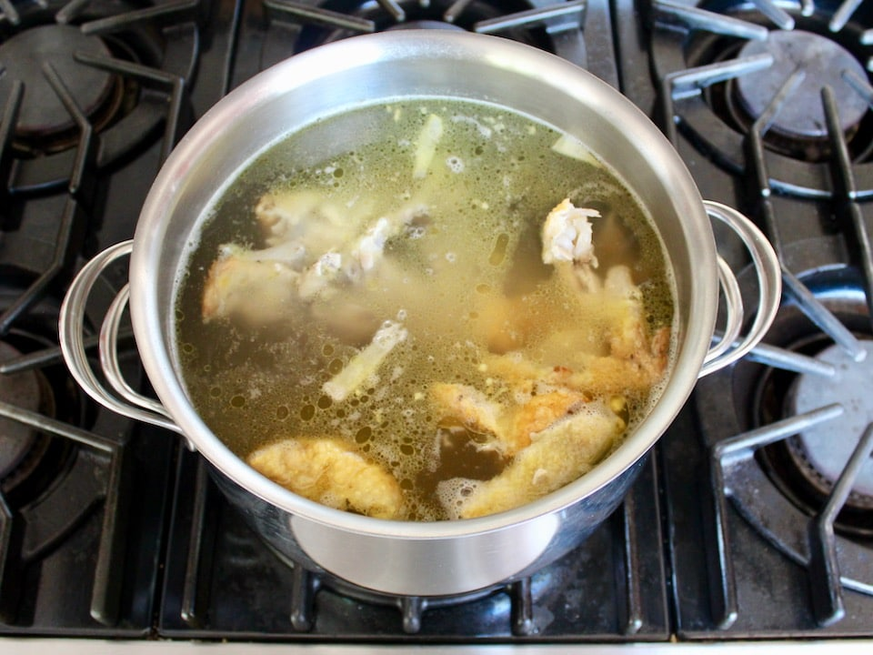 Bringing chicken stock with roast chicken carcass to a simmer, not much foam.