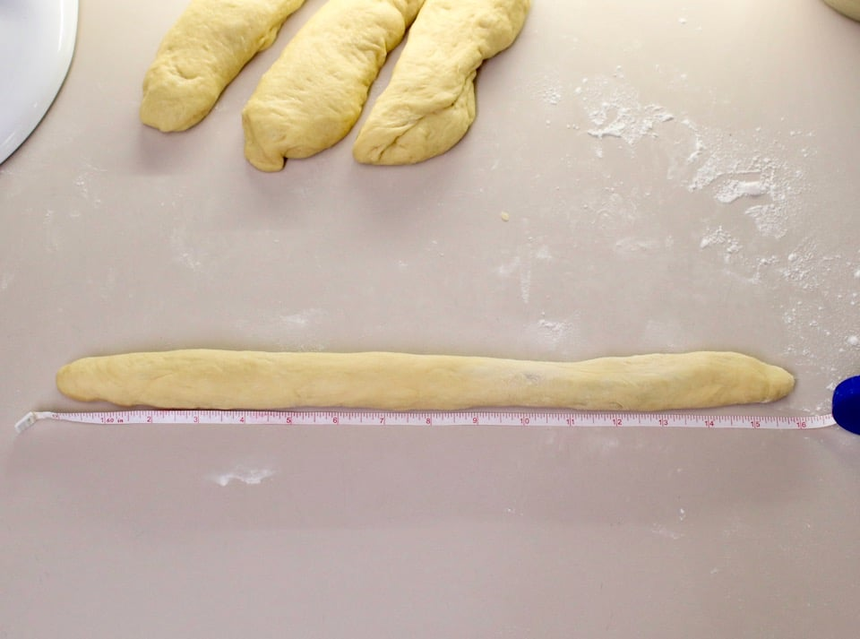 Over head shot of challah dough in a long strand.